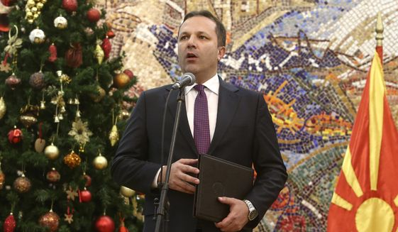 Oliver Spasovski, nominated to serve as prime minister of the caretaker government, talks for the media after receiving the mandate from the president Stevo Pendarovski, at the presidential office in Skopje, North Macedonia, Friday, Jan. 3, 2020.  The prime minister of North Macedonia Zoran Zaev submitted his resignation Friday, paving the way for a new caretaker Cabinet to be named in order to organize a snap election. (AP Photo/Boris Grdanoski)