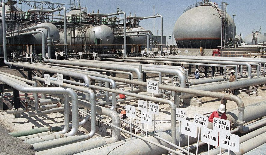 In this file photo dated 1990, Aramco refinery at Ras Tannura, Saudi Arabia. The price of oil surged Friday, Jan. 3, 2020, as global investors were gripped with uncertainty over the potential repercussions and any retaliation after the United States killed Iran's top general Qassem Soleimani. (AP Photo/FILE)