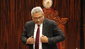 Sri Lankan President Gotabaya Rajapaksa leaves after addressing the parliament during the ceremonial inauguration of the session, in Colombo, Sri Lanka, Friday, Jan. 3, 2020. (AP Photo/Eranga Jayawardena)