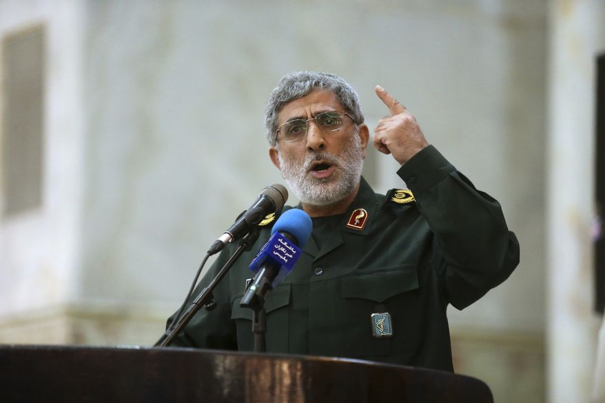 In this May 24, 2017 file photo, Gen. Esmail Ghaani speaks in a meeting at the shrine of the late revolutionary founder Ayatollah Khomeini just outside Tehran, Iran. (Hossein Zohrevand/Tasnim News Agency via AP) **FILE**