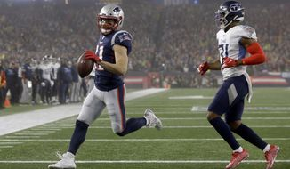 New England Patriots wide receiver Julian Edelman runs for a touchdown past Tennessee Titans safety Kevin Byard, left, in the first half of an NFL wild-card playoff football game, Saturday, Jan. 4, 2020, in Foxborough, Mass. (AP Photo/Steven Senne) ** FILE **