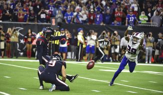 Houston Texans kicker Ka'imi Fairbairn (7) kicks a game-winning 28-yard field goal as Buffalo Bills cornerback Kevin Johnson (29) tries to block the kick during overtime of an NFL wild-card playoff football game Saturday, Jan. 4, 2020, in Houston. The Texans won 22-19. (AP Photo/Eric Christian Smith)