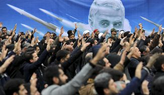 "Protesters demonstrate over the U.S. airstrike in Iraq that killed Iranian Revolutionary Guard Gen. Qassem Soleimani in Tehran, Iran, Saturday Jan. 4, 2020. Iran has vowed ""harsh retaliation"" for the U.S. airstrike near Baghdad's airport that killed Tehran's top general and the architect of its interventions across the Middle East, as tensions soared in the wake of the targeted killing. (AP Photo/Ebrahim Noroozi)"