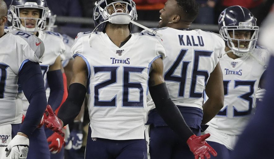 Tennessee Titans cornerback Logan Ryan celebrates his interception for a touchdown against the New England Patriots in the second half of an NFL wild-card playoff football game, Saturday, Jan. 4, 2020, in Foxborough, Mass. (AP Photo/Steven Senne)