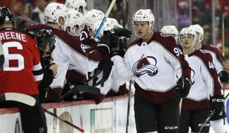 Teammates congratulate Colorado Avalanche right wing Mikko Rantanen (96,) of Finland, after he scored a goal during the second period of the team's NHL hockey game against the New Jersey Devils, Saturday, Jan. 4, 2020, in Newark, N.J. (AP Photo/Kathy Willens)