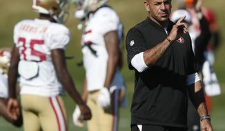 FILE - In this Aug. 17, 2019 file photo, San Francisco 49ers defensive coordinator Robert Saleh directs players during a combined NFL training camp with the Denver Broncos at the Broncos' headquarters in Englewood, Colo.  The Cleveland Browns are meeting with Saleh about their coaching job. Saleh's defense dominated Cleveland in a game this season. Browns owner Jimmy Haslam and members of the team's search committee will interview Saleh on Saturday, Jan. 4, 2020.(AP Photo/David Zalubowski, File)
