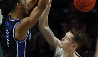 Duke guard Cassius Stanley (2) dunks the ball against Miami forward Sam Waardenburg (21) during the first half an NCAA college basketball game, Saturday, Jan. 4, 2020, in Coral Gables, Fla. (AP Photo/Wilfredo Lee)
