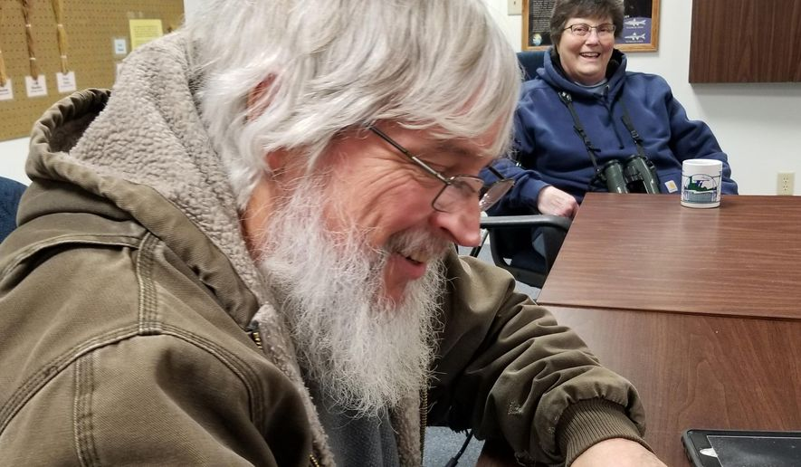 In this Dec. 27, 2019, photo, Ron Martin, of Minot, N.D., assists fellow birders in Foxholm, N.D., prior to venturing out for the annual bird count at Upper Souris National Wildlife Refuge. He has been organizing Christmas Bird Counts in the Minot area for several years. (Kim Fundingsland/Minot Daily News via AP)