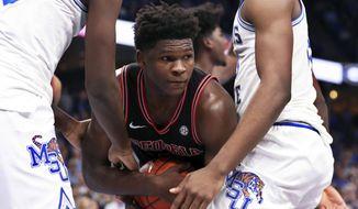 Georgia guard Anthony Edwards ( 5 ) grabs a rebound in the first half of an NCAA college basketball game against Memphis, Saturday, Jan. 4, 2020, in Memphis, Tenn. (AP Photo/Karen Pulfer Focht)
