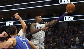 Charlotte Hornets guard Terry Rozier (3) shoots past Dallas Mavericks forward Dwight Powell (7) in the first half in an NBA basketball game Saturday, Jan. 4, 2020, in Dallas. (AP Photo/Richard W. Rodriguez)