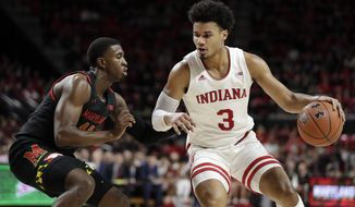 Indiana forward Justin Smith (3) drives against Maryland guard Darryl Morsell during the first half of a NCAA college basketball game, Saturday, Jan. 4, 2020, in College Park, Md. (AP Photo/Julio Cortez)