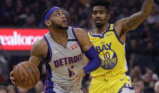 Detroit Pistons' Bruce Brown, left, looks to shoot against Golden State Warriors' Jacob Evans (10) during the first half of an NBA basketball game Saturday, Jan. 4, 2020, in San Francisco. (AP Photo/Ben Margot)