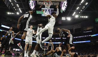 Milwaukee Bucks' Wesley Matthews shoots during the first half of an NBA basketball game against the San Antonio Spurs Saturday, Jan. 4, 2020, in Milwaukee. (AP Photo/Morry Gash)
