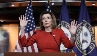 House Speaker Nancy Pelosi, D-Calif., meets with reporters at the Capitol in Washington, Thursday, Dec. 19, 2019, on the day after the House of Representatives voted to impeach President Donald Trump on two charges, abuse of power and obstruction of Congress. (AP Photo/J. Scott Applewhite) ** FILE **
