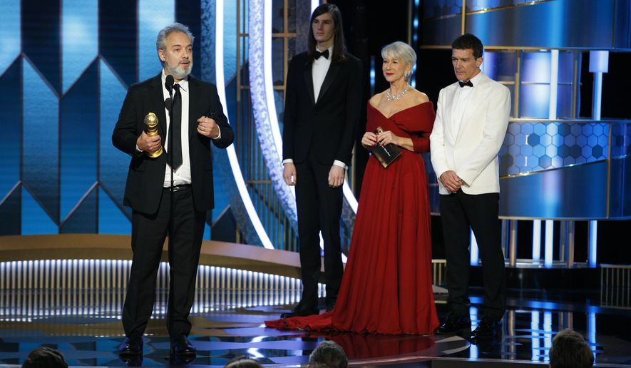 """This image released by NBC shows Sam Mendes accepting the award for best director for the film """"1917"""" as presenters Antonio Banderas, right, and Helen Mirren look on at the 77th Annual Golden Globe Awards at the Beverly Hilton Hotel in Beverly Hills, Calif., on Sunday, Jan. 5, 2020. (Paul Drinkwater/NBC via AP)"""