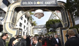 Media set up on the red carpet prior to the start of the 77th annual Golden Globe Awards at the Beverly Hilton Hotel on Sunday, Jan. 5, 2020, in Beverly Hills, Calif. (Photo by Jordan Strauss/Invision/AP)