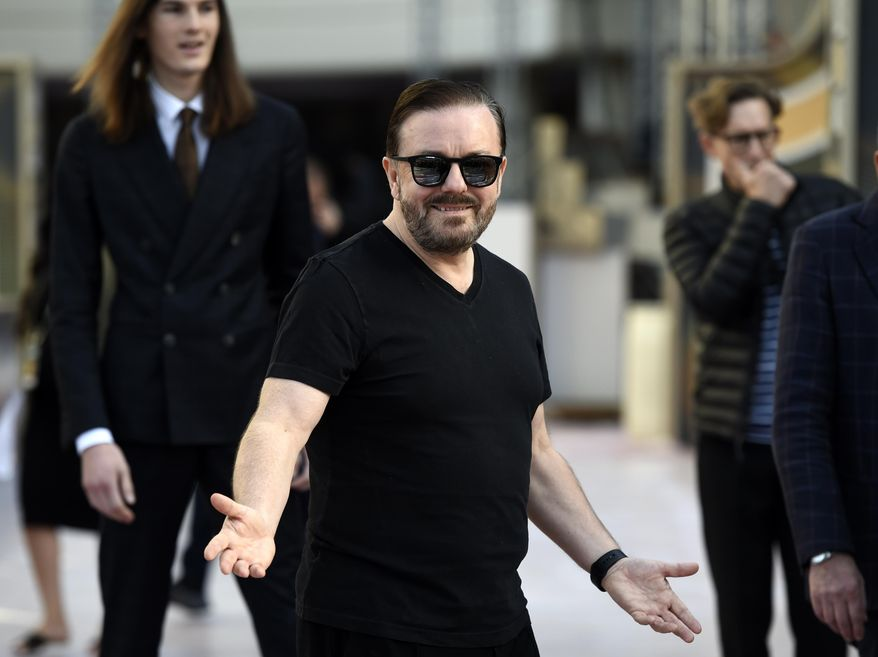 Ricky Gervais, host of the 77th Annual Golden Globe Awards, reacts to photographers during Preview Day for the Globes at the Beverly Hilton, Friday, Jan. 3, 2020, in Beverly Hills, Calif. The annual awards show recognizing excellence in film and television will be held on Sunday. (AP Photo/Chris Pizzello)