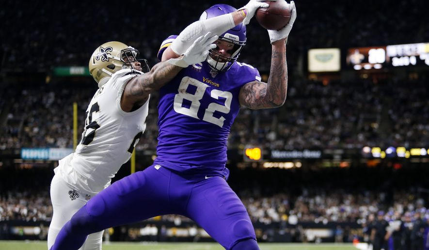Minnesota Vikings tight end Kyle Rudolph (82) pulls in the game winning touchdown pass over New Orleans Saints cornerback P.J. Williams during overtime of an NFL wild-card playoff football game, Sunday, Jan. 5, 2020, in New Orleans. The Vikings won 26-20. (AP Photo/Brett Duke)