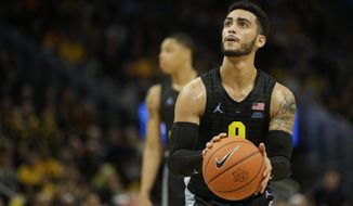 Marquette's Markus Howard shoots a free throw during the first half of an NCAA college basketball game against Villanova Saturday, Jan. 4, 2020, in Milwaukee. (AP Photo/Aaron Gash) ** FILE **