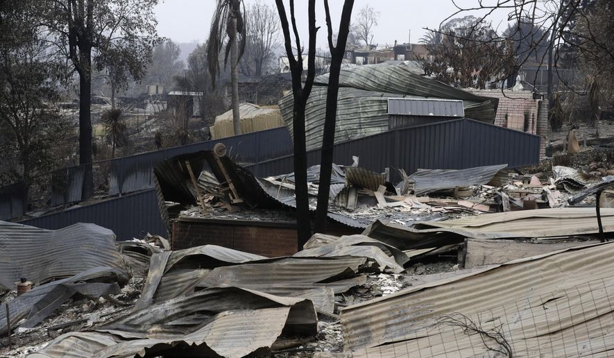 Houses are flattened at Conjola Park, Australia, Sunday, Jan. 5, 2020, after recent wildfires ripped through the community. The deadly wildfires, which have been raging since September, have already burned about 5 million hectares (12.35 million acres) of land and destroyed more than 1,500 homes. (AP Photo/Rick Rycroft)