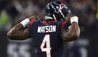 Houston Texans quarterback Deshaun Watson (4) celebrates after throwing a pass to setup the game-winning field goal during overtime of an NFL wild-card playoff football game against the Buffalo Bills Saturday, Jan. 4, 2020, in Houston. The Texans won 22-19 in overtime. (AP Photo/Eric Christian Smith)