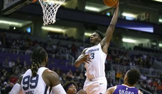 Memphis Grizzlies forward Jaren Jackson Jr. (13) dunks against the Phoenix Suns in the first half during an NBA basketball game, Sunday, Jan. 5, 2020, in Phoenix. (AP Photo/Rick Scuteri)