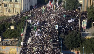 An aerial view shows mourners attending a funeral ceremony for Gen. Qassem Soleimani and his comrades, who were killed in Iraq in a U.S. drone strike, in the southwestern city of Ahvaz, Iran, Sunday, Jan. 5, 2020. The body of Gen. Qassem Soleimani arrived Sunday in Iran to throngs of mourners, as President Donald Trump threatened to bomb 52 sites in the Islamic Republic if Tehran retaliates by attacking Americans. (Morteza Jaberian/Mehr News Agency via AP)