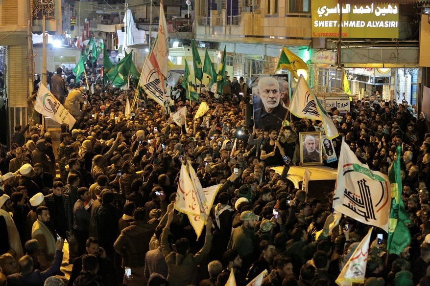 """Mourners carry the coffins of Iran's Gen. Qassem Soleimani and Abu Mahdi al-Muhandis, deputy commander of Iran-backed militias at the Imam Ali shrine in Najaf, Iraq, Saturday, Jan. 4, 2020. Iran has vowed """"harsh retaliation"""" for the U.S. airstrike near Baghdad's airport that killed Tehran's top general and the architect of its interventions across the Middle East, as tensions soared in the wake of the targeted killing. (AP Photo/Anmar Khalil)"""