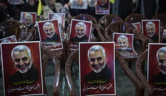 "Posters of slain Iranian Revolutionary Guard Gen. Qassem Soleimani are placed on chairs as supporters of Hezbollah leader Sayyed Hassan Nasrallah gather for his televised speech in a southern suburb of Beirut, Lebanon, Sunday, Jan. 5, 2020 following the U.S. airstrike in Iraq that killed Soleimani. The posters read: ""Sayyad of martyrs in the axis of resistance. The martyr Hajj Qassem Soleimani."" (AP Photo/Maya Alleruzzo)"