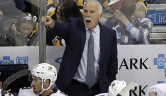 Florida Panthers head coach Joel Quenneville gives instructions during the first period of an NHL hockey game against the Pittsburgh Penguins in Pittsburgh, Sunday, Jan. 5, 2020. (AP Photo/Gene J. Puskar)