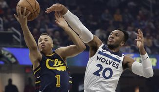 Cleveland Cavaliers' Dante Exum (1) drives to the basket against Minnesota Timberwolves' Josh Okogie (20) in the first half of an NBA basketball game, Sunday, Jan. 5, 2020, in Cleveland. (AP Photo/Tony Dejak)