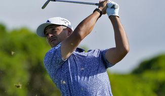 Xander Schauffele hits from the 11th tee during final round of the Tournament of Champions golf event, Sunday, Jan. 5, 2020, at Kapalua Plantation Course in Kapalua, Hawaii. (AP Photo/Matt York)