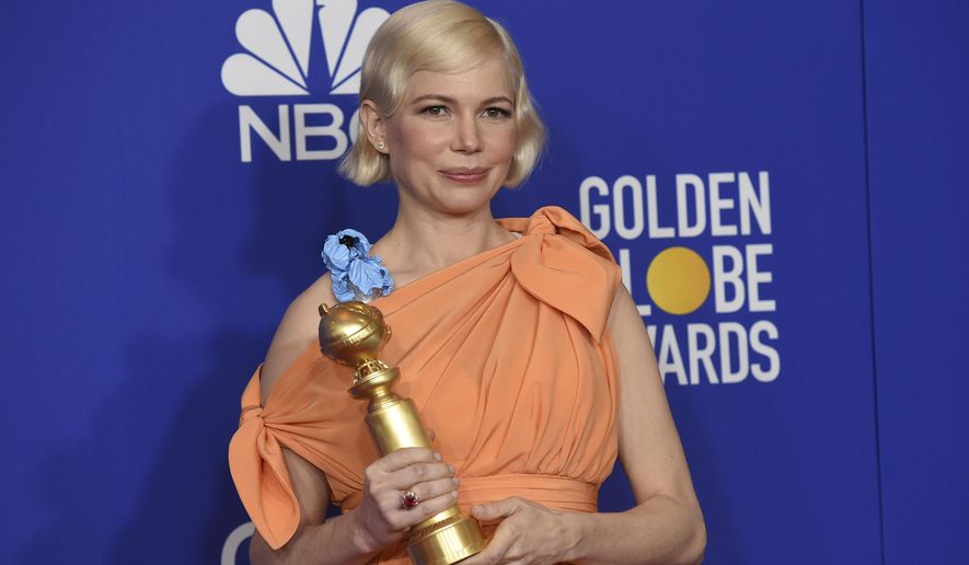 """Michelle Williams poses in the press room with the award for best television performance by an actress in a limited series or a motion picture made for television for """"Fosse/Verdon"""" at the 77th annual Golden Globe Awards at the Beverly Hilton Hotel on Sunday, Jan. 5, 2020, in Beverly Hills, Calif. (AP Photo/Chris Pizzello)"""