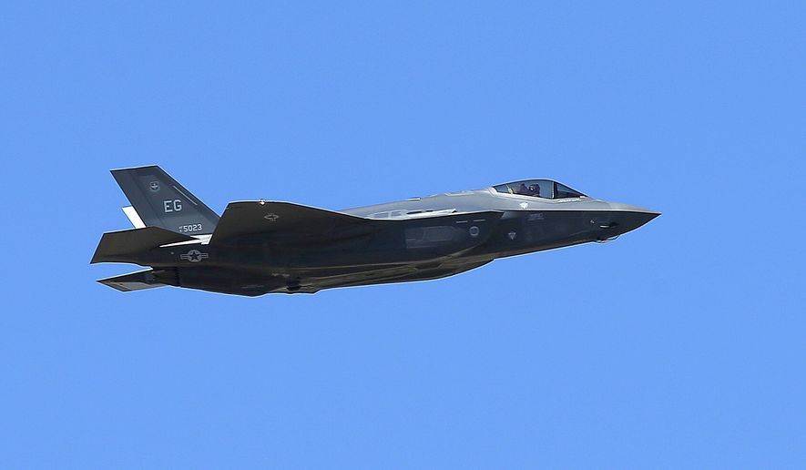 In this March 14, 2014, file photo, a U.S. Air Force F-35A Lightning II makes a flyby after an unveiling celebration takes place at Luke Air Force Base for the delivery of the first F-35A fighter jet, in Glendale, Ariz.  The U.S. Air Force has selected National Guard bases in Alabama and Wisconsin as homes for new F-35A fighter squadrons. Air Force officials announced Thursday, Dec. 21, 2017, that Truax Field Air National Guard Base in Wisconsin and Dannelly Field in Montgomery, Alabama are the preferred locations for the squadrons.   (AP Photo/Ross D. Franklin, File)