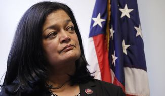 Rep. Pramila Jayapal, D-Wash., looks on at a news conference in her office Monday, Jan. 6, 2020, in Seattle. Civil rights groups and lawmakers were demanding information from federal officials following reports that dozens of Iranian-Americans were held up and questioned at the border as they returned to the United States from Canada over the weekend. In a statement Sunday, the Washington state chapter of the Council on American-Islamic Relations said more than 60 Iranians and Iranian-Americans were detained and questioned at the Peace Arch Border Crossing in Blaine, Washington. (AP Photo/Elaine Thompson)