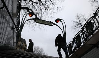 CORRECTING OBJECT NAME TO FRANCE STRIKES - Commuters exit the Paris subway during the 32nd day of transport strikes, Sunday, Jan. 5, 2020. With more than 30 straight days of walkouts, French rail strikes against government plans to reform France's retirement system marked a new milestone, surpassing even the lengths of strikes in the 1980s. (AP Photo/Christophe Ena)