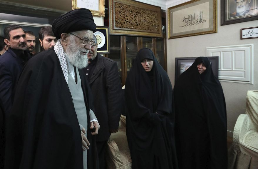 """In this picture released by the official website of the office of the Iranian supreme leader, Supreme Leader Ayatollah Ali Khamenei meets family of Iranian Revolutionary Guard Gen. Qassem Soleimani, who was killed in the U.S. airstrike in Iraq, at his home in Tehran, Iran, Friday, Jan. 3, 2020. Iran has vowed """"harsh retaliation"""" for the U.S. airstrike near Baghdad's airport that killed Tehran's top general and the architect of its interventions across the Middle East. (Office of the Iranian Supreme Leader via AP)"""