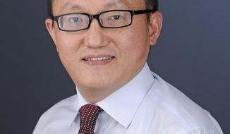 This undated photo provided by the University of Kansas shows researcher Franklin Feng Tao. A federal judge will hear arguments Monday, Jan. 6, 2020, on whether to toss out the indictment against Feng, accused of secretly working for a Chinese university. Attorneys for Feng have accused a visiting scholar of fabricating the allegations after unsuccessfully trying to extort him. The government alleges Feng failed to report that he was working for Fuzhou University in China while doing research in Kansas on projects funded by the U.S. government. (Kelsey Kimberlin/University of Kansas via AP)