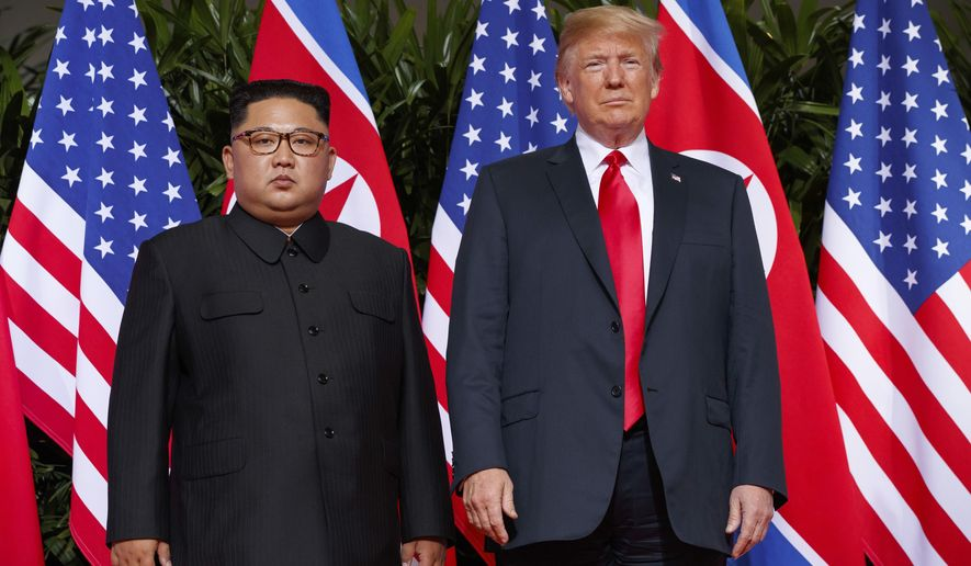 In this June 12, 2018, file photo, U.S. President Donald Trump, right, meets with North Korean leader Kim Jong Un on Sentosa Island, in Singapore. The U.S. strike that killed Iran's top military commander may have had an indirect casualty: a diplomatic solution to denuclearizing North Korea. Experts say the escalation of tensions between Washington and Tehran will diminish already fading hopes for such an outcome and inspire North Korea's decision-makers to tighten their hold on the weapons they see, perhaps correctly, as their strongest guarantee of survival. (AP Photo/Evan Vucci, File)