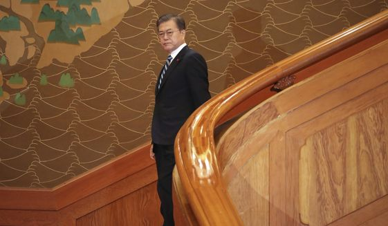 South Korean President Moon Jae-in arrives for his New Year's speech at the presidential Blue House in Seoul, South Korea, Tuesday, Jan. 7, 2020. Moon said he hopes to see North Korean leader Kim Jong Un fulfill a promise to visit the South this year as he called for the rival Koreas to end a prolonged freeze in bilateral relations. (Lee Jin-wook/Yonhap via AP)