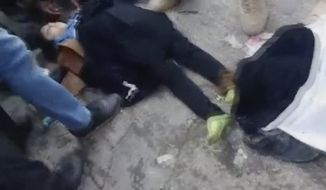 In this frame grab from video posted online, people try to resuscitate victims of a deadly stampede at a funeral procession for a top Iranian general killed in a U.S. airstrike last week, in Kerman, Iran, Tuesday, Jan. 7, 2019. Two Iranian semi-official news agencies reported that the stampede in Kerman that killed dozens of people and injured over 200 others took place in Kerman, the hometown of Revolutionary Guard Gen. Qassem Soleimani, as the procession got underway. (AP Photo)
