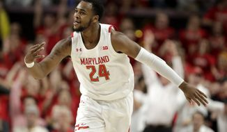 Maryland forward Donta Scott reacts after scoring a three point basket against Ohio State during the first half of an NCAA college basketball game, Tuesday, Jan. 7, 2020, in College Park, Md. (AP Photo/Julio Cortez)