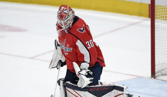 Washington Capitals goaltender Ilya Samsonov (30), of Russia, stops the puck during the third period of an NHL hockey game against the Ottawa Senators, Tuesday, Jan. 7, 2020, in Washington. The Capitals won 6-1. (AP Photo/Nick Wass)