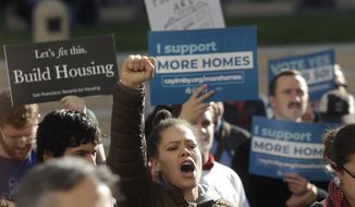 Nikia Durgin, who raps under the name Qing Qi, yells at a rally outside of City Hall in Oakland, Calif., Tuesday, Jan. 7, 2020. California Sen. Scott Wiener announced amendments to a closely-watched bill that would allow more housing to be built near public transportation. (AP Photo/Jeff Chiu)