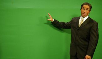"""In this Oct. 5, 2006 photo, KRQE-TV Chief Meteorologist Mark Ronchetti stands in front of a """"green screen"""" as he gives the weathercast at the KRQE studios in Albuquerque, N.M. Ronchetti announced Tuesday, Jan. 7, 2020, that he is joining the race for U.S. Senate in New Mexico. Ronchetti is jumping in the contest for the GOP nomination after stepping down for his job as chief meteorologist for the CBS affiliate in Albuquerque. (Jaelyn deMaria/The Albuquerque Journal via AP)/The Albuquerque Journal via AP)"""