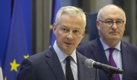 French Finance Minister Bruno Le Maire, left, and European Trade Commissioner Phil Hogan attend a media conference after their meeting in Paris, Tuesday, Jan. 7, 2020. The talks are focused on U.S. tariffs on French wine and other goods. (AP Photo/Michel Euler)