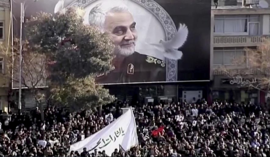 In this image made from a video, mourners gather to pay their respects to the slain Gen. Qassem Soleimani who was killed in a U.S. airstrike, in Kerman, Iran Tuesday, Jan. 7, 2020. (Iran Press via AP)
