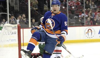 New York Islanders center Casey Cizikas celebrates his goal during the first period of an NHL hockey game against the New Jersey Devils Tuesday, Jan. 7, 2020, in Newark, N.J. (AP Photo/Bill Kostroun)
