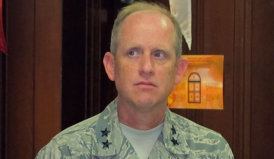 FILE - In this Sept. 7, 2012, file photo, then-Wisconsin Army National Guard Maj. Gen. Don Dunbar listens during a news conference in Milwaukee. The National Guard's headquarters opened an investigation during the fall of 2019 into allegations that Adj. Gen. Donald Dunbar improperly initiated an internal investigation in a sexual assault case even as he was under scrutiny for allegedly mishandling sexual assault complaints, Gov. Tony Evers' office said Tuesday, Jan. 7, 2020. (AP Photo/Dinesh Ramde, File)