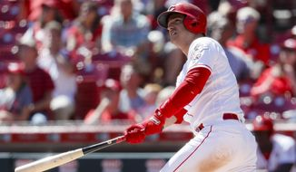 FILE - In this Sept. 5, 2019, file photo, Cincinnati Reds' Jose Iglesias hits a two-run home run off Philadelphia Phillies starting pitcher Jason Vargas in the sixth inning of a baseball game in Cincinnati. The Baltimore Orioles filled a hole in the middle of the infield by agreeing to a $3 million, one-year contract with Iglesias, a person familiar with the situation told The Associated Press. The person spoke to the AP on condition of anonymity Monday, Jan. 6, 2020, because no official announcement had been made. (AP Photo/John Minchillo, File)